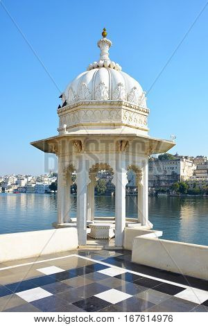 UDAIPUR INDIA - JANUARY 13 2017: Taj Lake Palace Hotel Rooftop View. One of the most recognizable residences in the world looking over Lake Pichola.