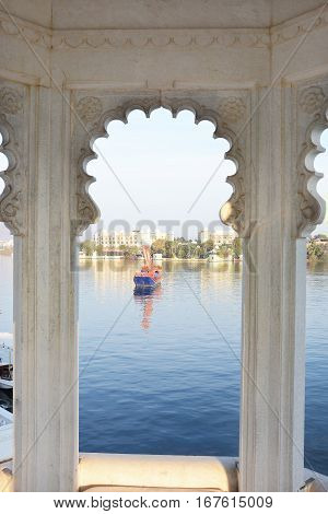 UDAIPUR INDIA - JANUARY 13 2017: Ganguar Ceremonial Barge at theTaj Lake Palace Hotel. The 150-year old boat is used for floating processions celebrating festivals and royal ceremonies.