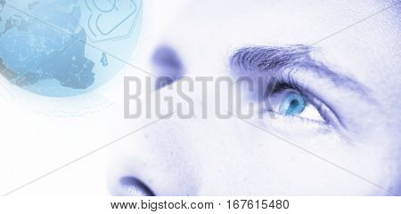 Digitally generated image of earth with social connectivity against cropped image of man with gray eyes