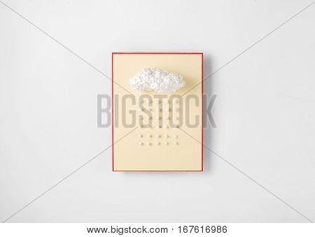 Styrofoam in the shape of the clouds with simulated rain or snow on a white background. Top view Flat lay