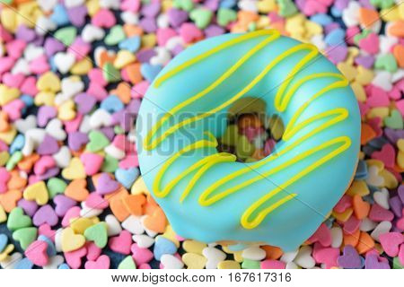 Sweet donuts decorated with icing close up