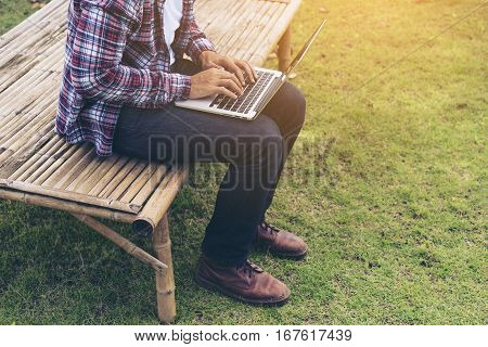 Man Working On Laptop. Nature Background.