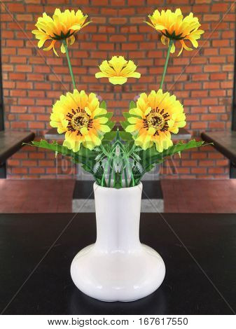 Yellow flower in vase on table decoration