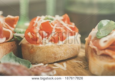 Close up bruschetta with tomato parmesan cheese and basil