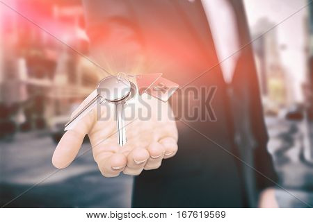Metallic key with red home ring against new york street