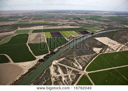 Aerial of produce fields along the Gila River near Yuma, Arizona poster