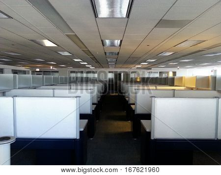 rows of cubicles in a new office space inside an office building