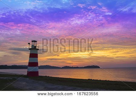 Lighthouse Seascape Sunset And Twilight Evening Time