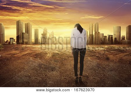 Rear View Of Asian Business Woman With Sad Expression Looking Changing Environment