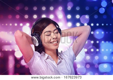 Beautiful Asian Woman Listening Music In Headphone