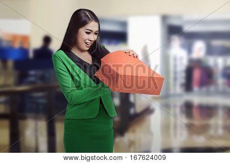 Beautiful Asian Business Woman Opening Her Shopping Bag