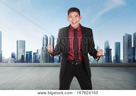 Young Asian Businessman With Happy Expression