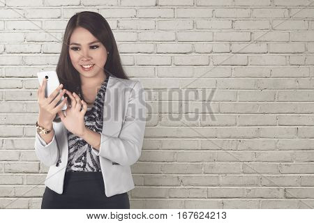 Smiling Asian Business Woman Using A Mobile Phone