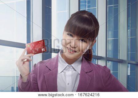 Beautiful Asian Business Woman Holding Credit Card