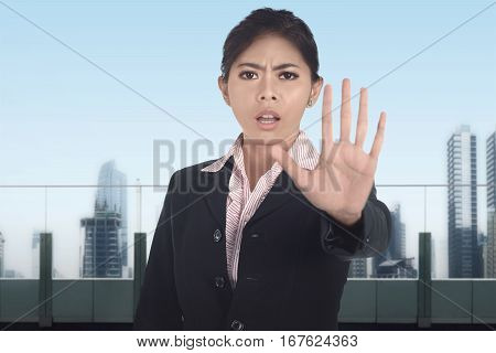 Young Asian Business Woman Show No Gesture With Serious Expression
