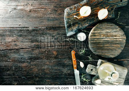 Various spices and condiments on wooden cutting boards