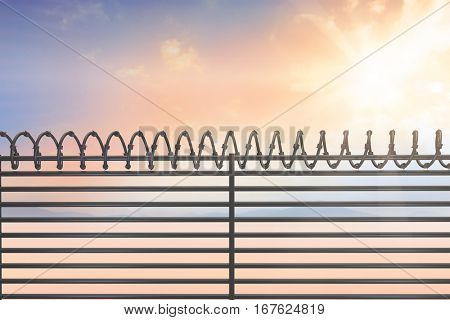 Digitallly generated image of barbed wire on fence against desert landscape
