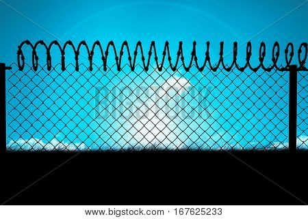 Chainlink fence against white background against blue sky over grass