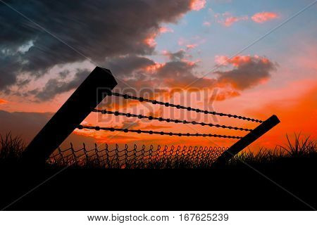 Bended barbed wire and chainlink fence against white background against sun set 3d