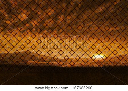 Chainlink fence against white background against beautiful african scene