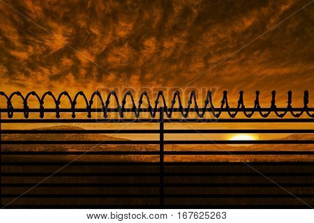 Digitallly generated image of barbed wire on fence against beautiful african scene 3d