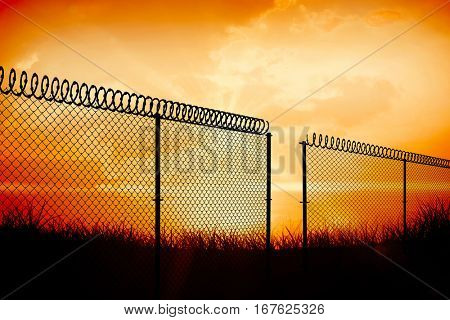Chainlink fence against white background against orange sunrise 3d