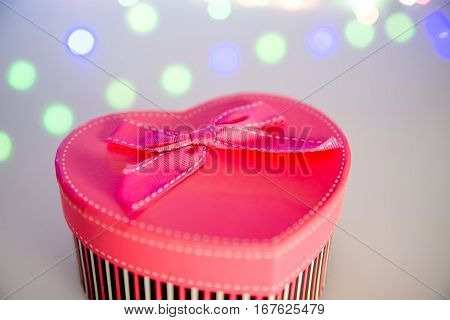 Pink gift box in the form of a heart close up