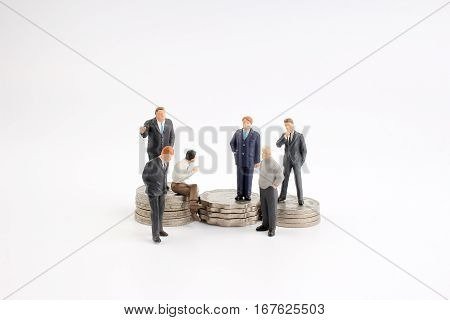 Business man figurine planning about retirement pension