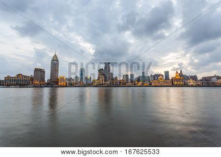 beautiful shanghai bund with huangpu river in nightfall