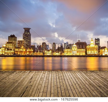 beautiful shanghai bund with sunset glow wooden floor as a prospect