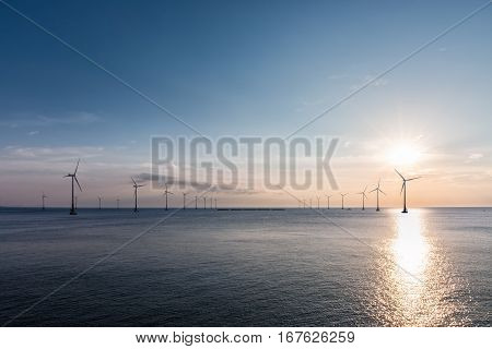 offshore wind farm at dusk renewable energy