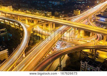 city interchange closeup at night aerial view of expressway traffic