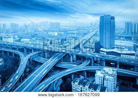 city overpass with blue tone expressway interchange and viaducts in hangzhou