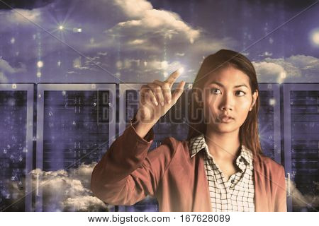 Businesswoman pointing against server room in blue