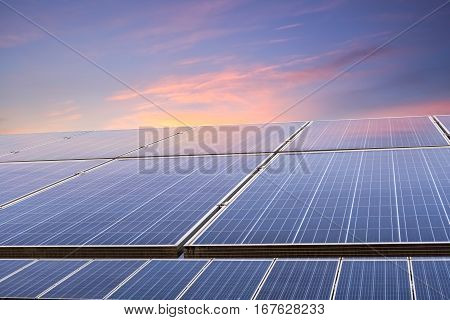 solar energy panels closeupphotovoltaic modules reflect sunset light and clouds