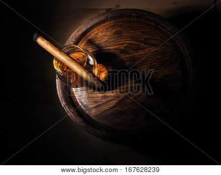 Cognac And Cigar On Old Oak Barrel