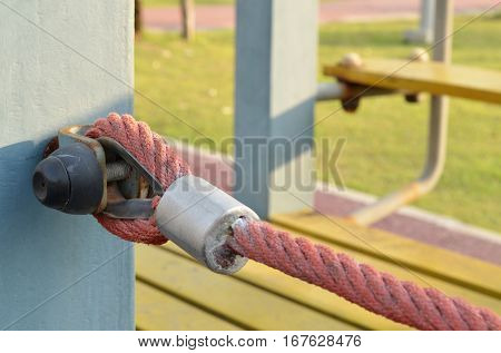 Rope tied with metal shackles in the playground,use a symbol for strength, tolerance, endeavor or commitment,construction equipment.