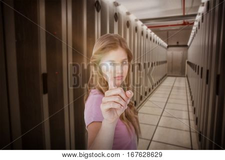 Pretty blonde pointing something with her finger against data center