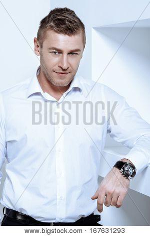 Business concept. Men's beauty, fashion. Handsome mature man wearing classic white shirt.