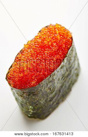 Japanese Sushi - Tobiko Gunkan Sushi (Nori wrapped Flying Fish Roe Sushi) on White Background