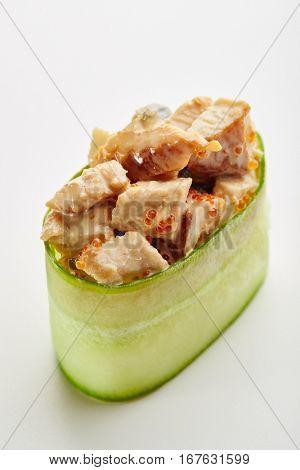 Japanese Sushi - Unagi Gunkan Sushi (Cucumber wrapped Smoked Eel Sushi) on White Background. Cucumber Slice outside