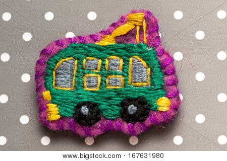 Homemade Embroidered Trolleybus On A Dots Grey Background