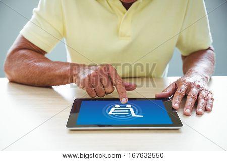 Trolley against senior man using a digital tablet