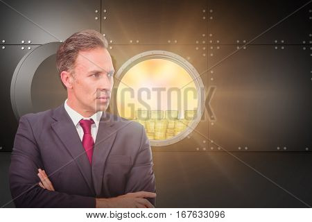 Businessman standing with arms crossed against digitally generated wide opened safe