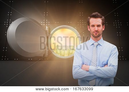 Serious manager with arms crossed in warehouse against digitally generated wide opened safe