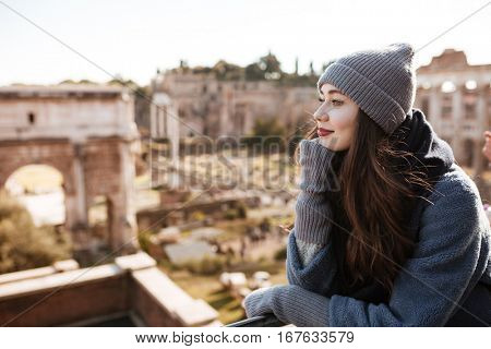 Beautiful young woman standing and enjoying the view in old city