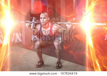 Full length of young man weightlifting in fitness studio