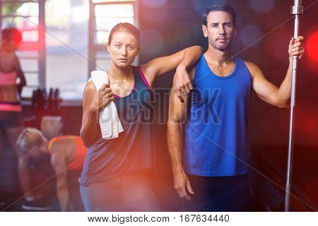 Portrait of fit serious friends standing in gym