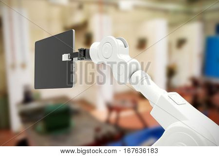Digital generated image of robot holding digital tablet against interior of factory 3d