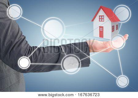 Businessman holding his hand out against purple vignette 3d